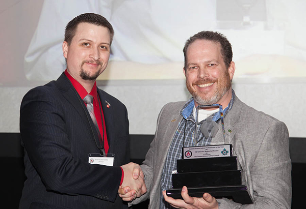 Ryan Jacobson, CEO of the Saskatchewan Safety Council (left), presents Jason Davidson with the award for the 2017 Safety Professional of the Year.